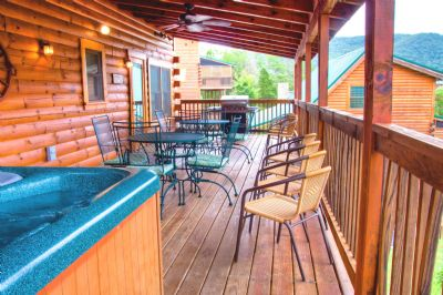 12 x 40 foot back deck w/ large hot tub, tables & gas grill
