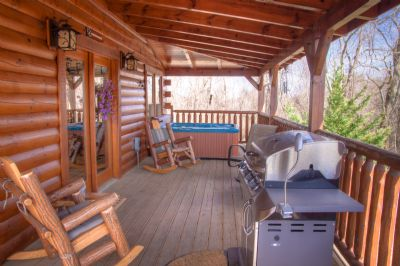 Rockers, gas grill, and hot tub.  This says it all.