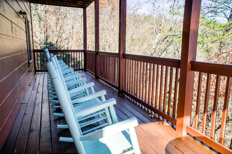 The lower level back deck has ten rocking chairs to enjoy th