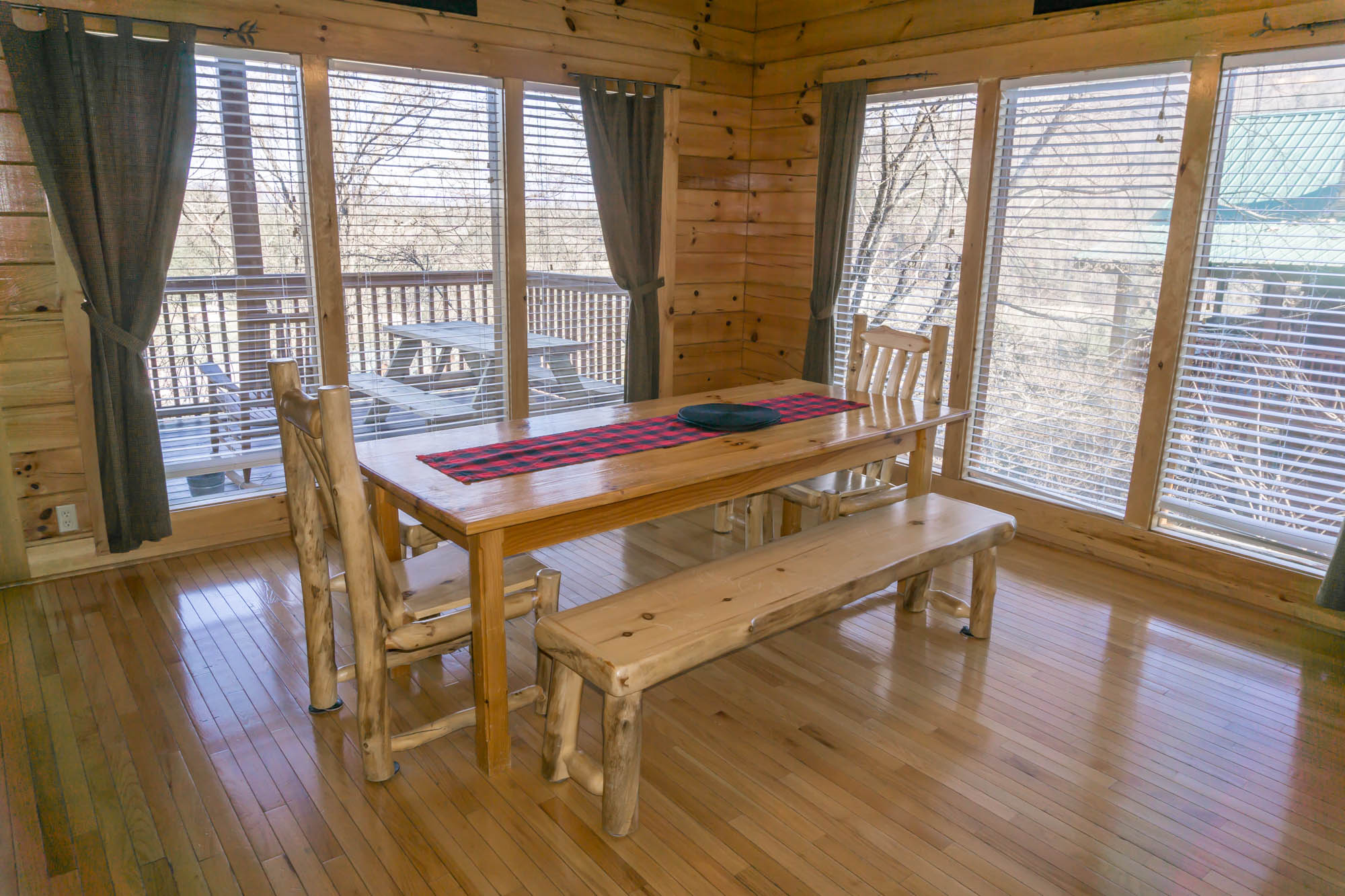 Dine in or sit out on the back deck picnic table
