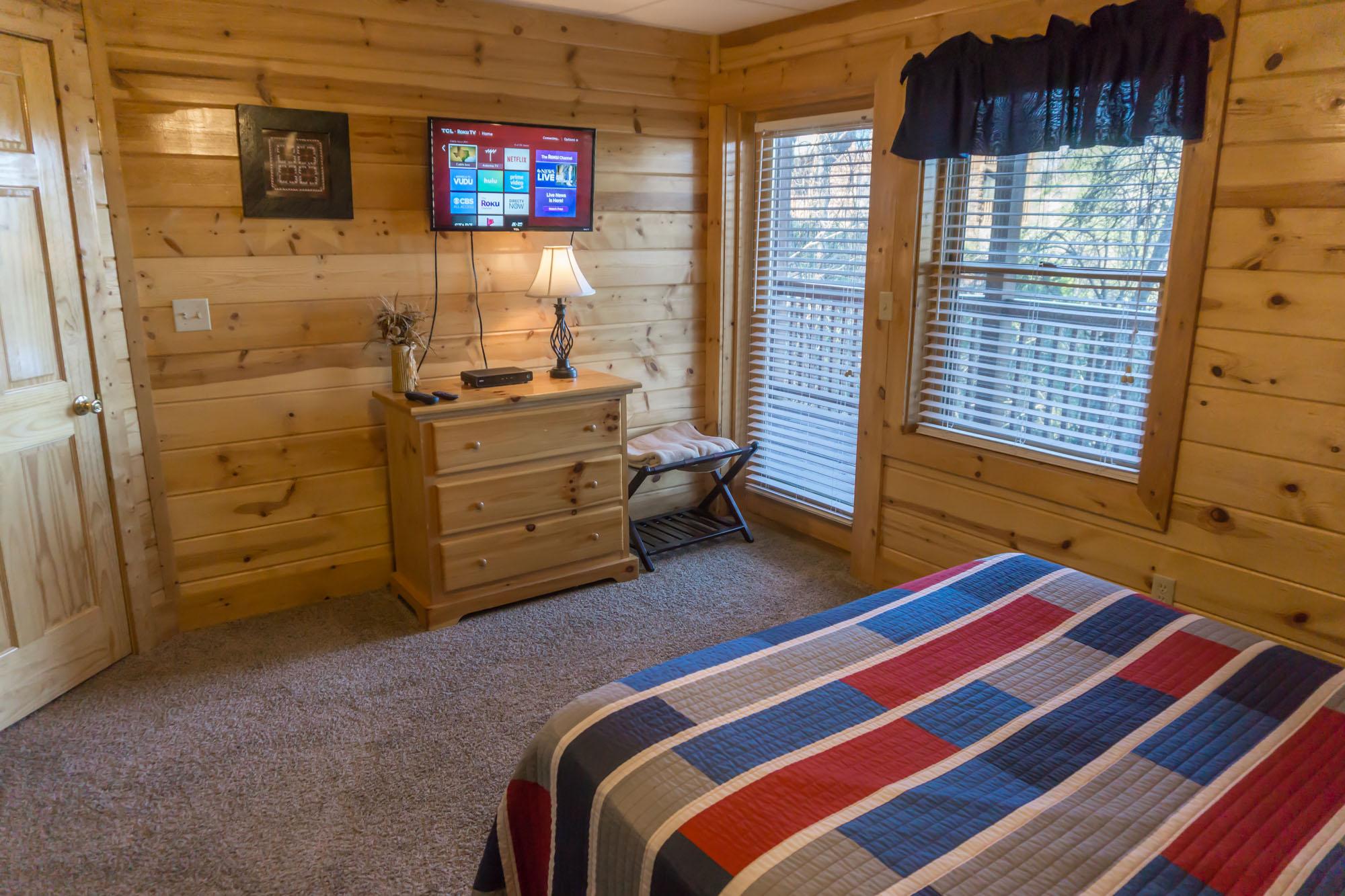Lower level queen back bedroom w/ door to deck