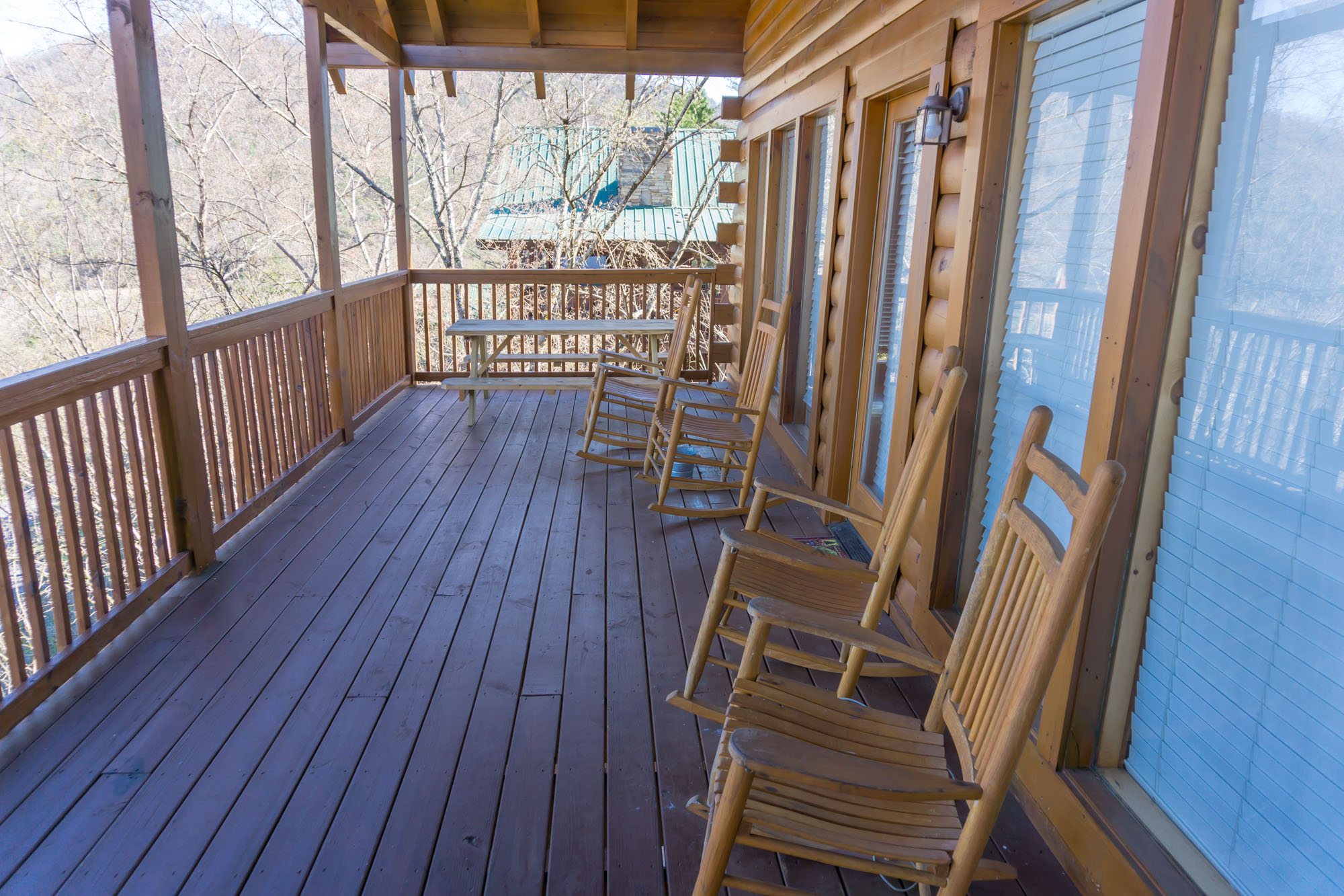 Main level deck w/ rockers and picnic table