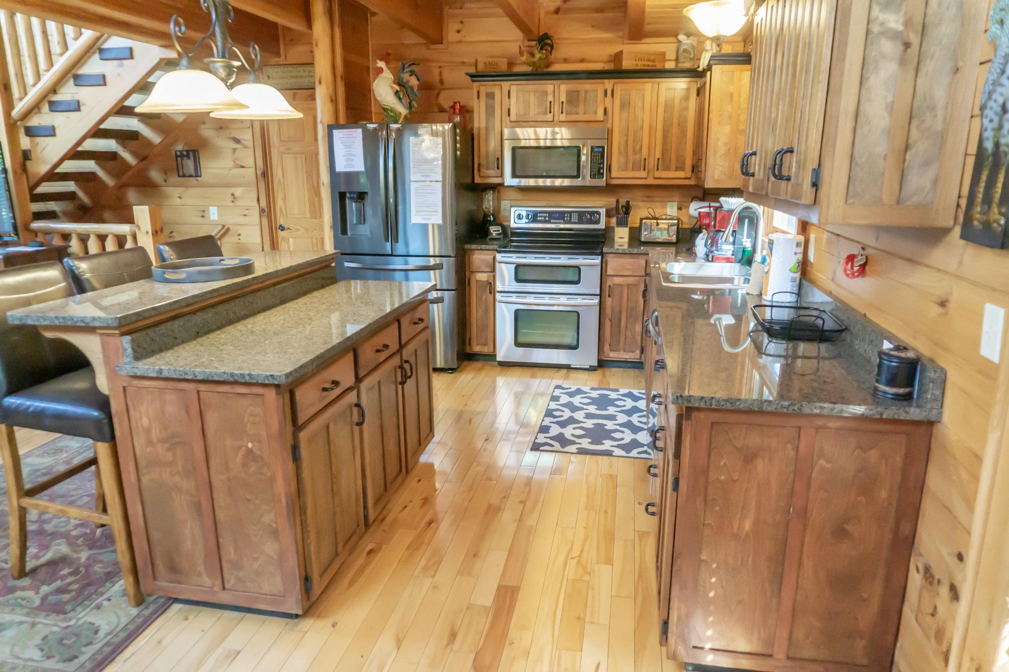 Granite countertops, double oven, large refrigerator & more