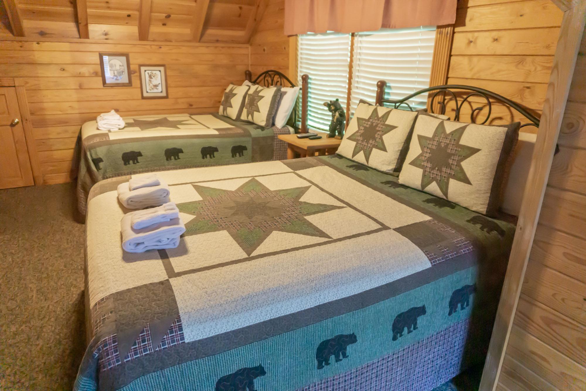 Upper level bedroom w/ 2 queen beds