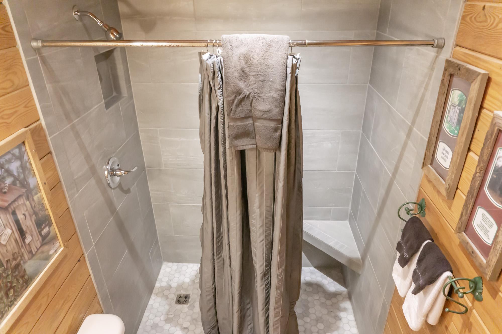 Upper level shower in bathroom
